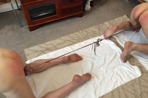 Tug of war with a difference! Spanked to encourage performance! If you like...