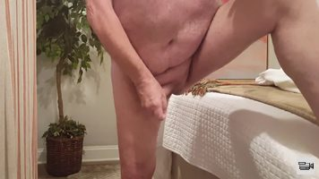 Stroking and tugging on my cock.